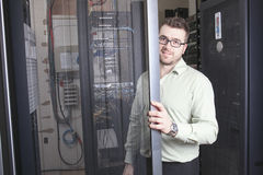 Network engineer working in server room Stock Photos