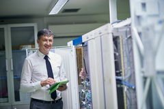 Network engineer working in  server room Royalty Free Stock Image