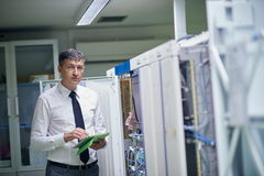 Network engineer working in  server room Royalty Free Stock Photos