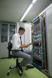 Network engineer working in  server room Stock Photo
