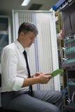 Network engineer working in  server room Royalty Free Stock Image