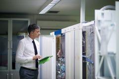 Network engineer working in  server room Stock Photos