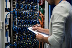 Network Engineer Writing Data Royalty Free Stock Images
