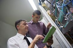 Network engineers in server room Stock Images