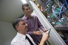 Network engineers in server room Royalty Free Stock Image