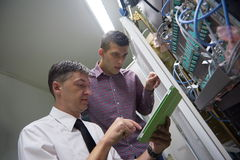 Network engineers in server room Stock Photo