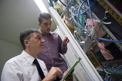 Network engineers in server room Royalty Free Stock Photos