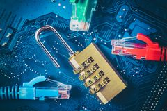 Network ethernet cables near opened padlock on computer motherboard. Internet data privacy information security concept. Blue tone stock images