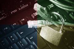Network ethernet cables in padlock on computer keyboard. Internet data privacy information security concept. Toned - 4 colors imag Stock Photography