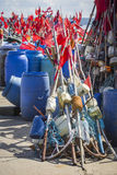 Network fishing drying on the beach in sunny day. Baltic Sea and Stock Image