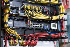 Network hub and patch cables Royalty Free Stock Photo