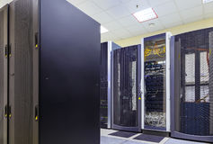 Network and internet communication technology concept, data center interior, server racks with telecommunication Stock Image