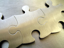 Network jigsaw. Metallic jigsaw on a steel background stock photo