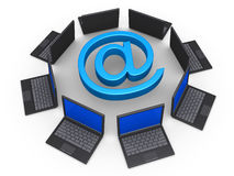 Network of laptops for communication with e-mail. 3d laptops around an e-mail symbol as network for communication concept Royalty Free Stock Photo
