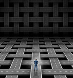 Network Manager. Concept with a businessman leader standing at a crossroad in front of roads and streets that are organized in a weaved grid pattern as a Stock Images