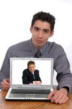 Network Meeting. A businessman displaying a computer during a teleconference Stock Image