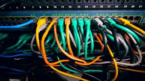 Network of multicolour plugged-in cables. 4K stock footage