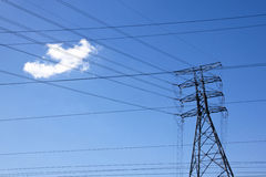 Network of Powerlines Against Bright Blue Sky Stock Photography