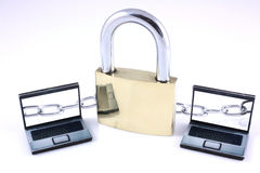Network Security. Two small Laptops and one large padlock linked with a chain royalty free stock photo