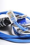 Network security concept. Two padlocks surrounded by blue network cables Stock Images
