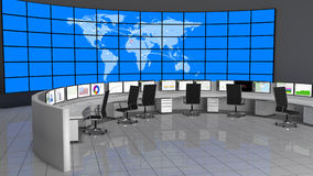 Network / Security Operations Center (NOC / SOC). Security Operations Center containing computers desks and a large screen containing the world map Stock Photo