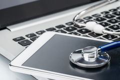 Network Security, stethoscope and Digital Tablet on laptop keybo Royalty Free Stock Images