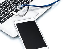 Network Security, stethoscope and Digital Tablet on laptop keybo Royalty Free Stock Photography