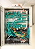 Network server cabinet with racks, cables, optical lines, ethernet switches and a wireless router in the data room of a school royalty free stock photo