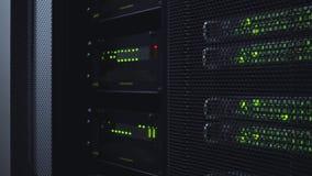 Network server room with racks in data center. Blink Led lamp. Dark server room. stock video
