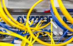 Network server room routers with fusebox panel blurred front background. Datacentre interface and equipment royalty free stock photo