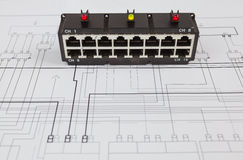 Network switch. On the blueprint of  communication equipment Royalty Free Stock Photos
