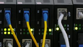 A network switch connected to the network transmits data. Telecommunication equipment of network cables in a datacenter of mobile operator stock footage