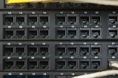 Network switch and ethernet cables. Network cables connected to switches Stock Photo