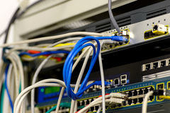 Network switch and ethernet cables Royalty Free Stock Image