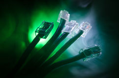 Network switch and ethernet cables, symbol of global communications. Colored network cables on dark background with lights and smo. Ke. Selective focus. Network Stock Photography