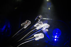 Network switch and ethernet cables, symbol of global communications. Colored network cables on dark background with lights and smo. Ke. Selective focus. Network Royalty Free Stock Photography