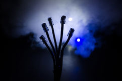 Network switch and ethernet cables, symbol of global communications. Colored network cables on dark background with lights and smo. Ke. Selective focus. Network Royalty Free Stock Photo