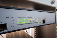 Network switch LED show online green and orange status stock photos