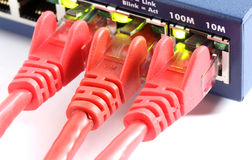 Network switch router with three red cables Stock Photo