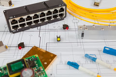 Network switch, UTP ethernet  and optical cable and other electronic components Stock Photo