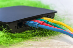Network switch with various color RJ45 cables connected for swit Stock Photos