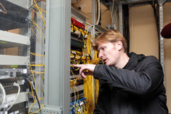 Network technician. The network technician is working on the telecom site royalty free stock photography