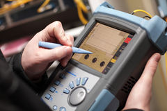 Network technician adjusting reflectometer Stock Image