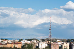 Network telecommunication tower on the city Stock Photo