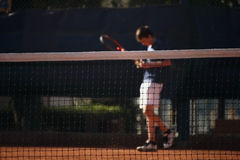 Network of the tennis court. Player behind the net of the tennis court royalty free stock images