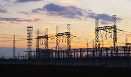 Network at transformer station in sunrise, high voltage Royalty Free Stock Photos