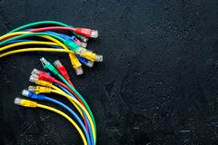 Network wires assorted colors with tips on black background top view copyspace Royalty Free Stock Images