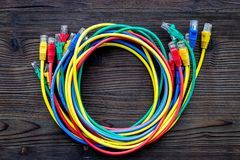 Network wires assorted colors with tips on dark wooden background top view Royalty Free Stock Photo