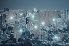 Network and world map on blur city royalty free stock photo