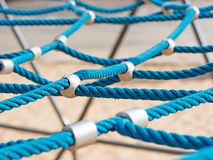 Networked ropes on climbing frame. Networked blue ropes on a climbing frame Royalty Free Stock Image